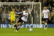 Derby County's Bradley Johnson first to the ball during the Sky Bet Championship match between Derby County and Burnley at the iPro Stadium, Derby, England on 21 September 2015. Photo by Aaron Lupton.