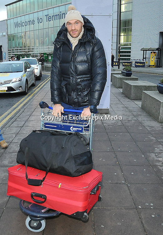 EXCLUSIVE<br /> THE NEXT TIME TYSON FURY STEPS INTO A BOXING RING IT WILL BE TO TAKE ON WORLD HEAVYWEIGHT CHAMPION OF 11 YEARS VLADIMAR KLITSCHKO.....TYSON FURY IS PICTURED AT MANCHESTER AIRPORT LATE ON SUNDAY AFTERNOON BEFORE CHECKING IN AND FLYING TO GERMANY<br /> &copy;Exclusivepix Media
