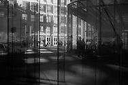 Paris, mirror reflection in arch of La defense, modern district / quartier de la defense