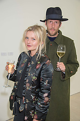 Actres SOPHIE KENNEDY CLARK and artist HENRY HUDSON at the opening of the exhibition Champagne Life in celebration of 30 years of The Saatchi Gallery, held on 12th January 2016 at The Saatchi Gallery, Duke Of York's HQ, King's Rd, London.