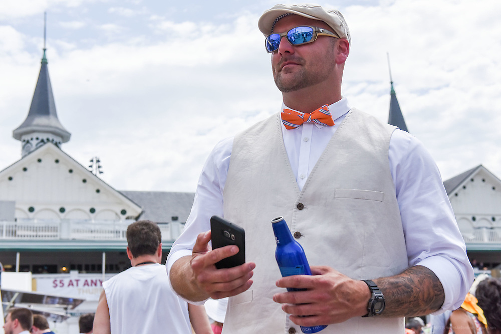 Micah Black of Erin, Tenn., stands outside the paddock area at the 142nd running of the Kentucky Derby. May 7, 2016