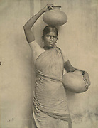 Woman with water pots.Photograph by Skeen.