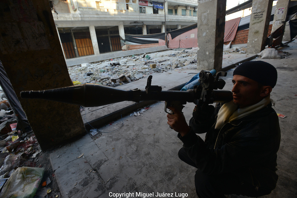 Aleppo, Syria, January, 2013 -  YOUSSEF, a former businessman and now an RPG fighter for the Free Syrian Army, aims at a Syrian position during fighting near a famous castle in the Old City section of Aleppo. (Photo by Miguel Juárez Lugo)