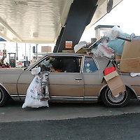 A woman (who asked not to be identified) stops to fill up her car at the Arco Gas station on Lincoln Boulevard and Rose Avenue in Venice on Tuesday, June 12, 2007. She claimed she was moving all of her belongings to Culver City ?in one trip!?