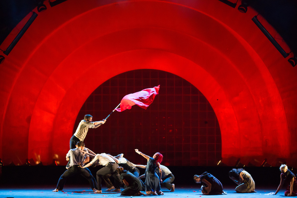 """A dancer waves a red flag near the end of Barak Marshall's ballet """"Harry"""", which deals with issues of life, death and conflict."""