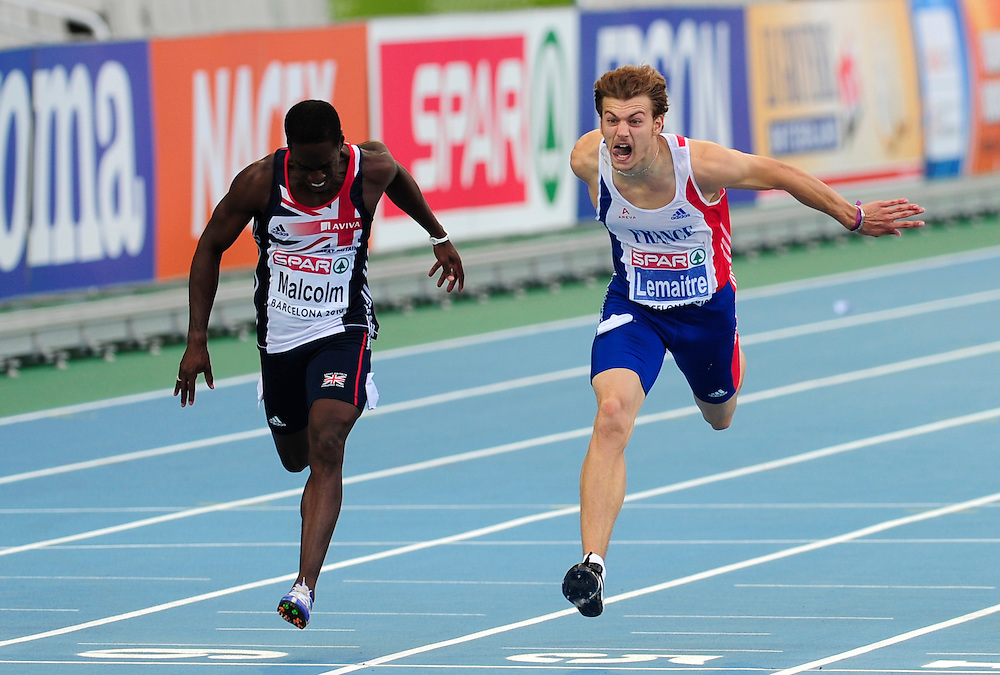France's Christophe Lemaitre (R) compete to cross first the finish line ahead of Great Britain's Christian Malcom in the men's 200m final at the 2010 European Athletics Championships at the Olympic Stadium in Barcelona.