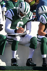Dec 23, 2012; East Rutherford, NJ, USA; New York Jets quarterback Mark Sanchez (6) sits on the bench during the first half at MetLIfe Stadium.