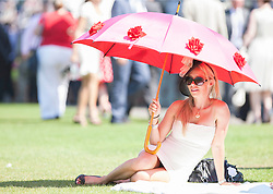 Racegoers enjoy the weather on Ladies Day at Glorious Goodwood in the UK  <br /> Thursday, 1st August 2013<br /> Picture by i-Images
