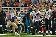 Jackson Jaguars running back Fred Taylor (28) races past St. Louis safety Mike Furrey (25) for a 71-yard touchdown run in the first quarter at the Edward Jones Dome in St. Louis, Missouri, October 30, 2005.  St. Louis beat Jacksonville 24-21.