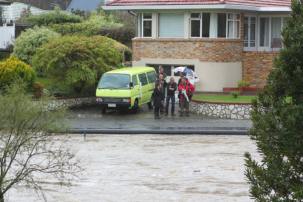 Nelson Avon Tce residents wait as the Maitai River rises causing flooding, Nelson, New Zealand, Monday, October 3, 2011, New Zealand. Credit:SNPA / Blair Hall