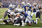 INDIANAPOLIS - JANUARY 21:  The football pops out of a pile of players after a New England Patriots fumble near the goal line against the Indianapolis Colts. The Patriots recovered the ball in the end zone for a touchdown during the 2006 AFC Championship game at the RCA Dome on January 21, 2007 in Indianapolis, Indiana. The Colts defeated the Pats 38-34. ©Paul Anthony Spinelli