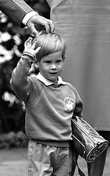 "File photo dated 16/09/87 of the three-year-old Duke of Sussex, then Prince Harry, arriving for his first day of nursery school at Chepstow Villas in west London with a Thomas the Tank Engine bag. The Duke of Sussex has recorded an on-camera introduction to the new animated special ""Thomas & Friends: The Royal Engine""."
