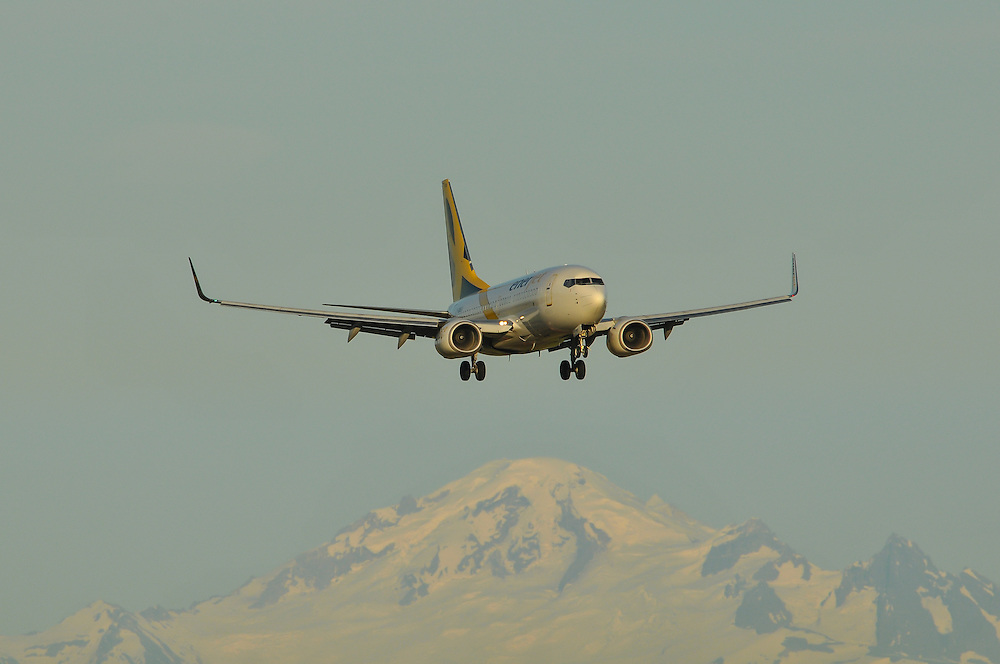 Enerjet Boeing 737 landing with Mt. Baker in the background