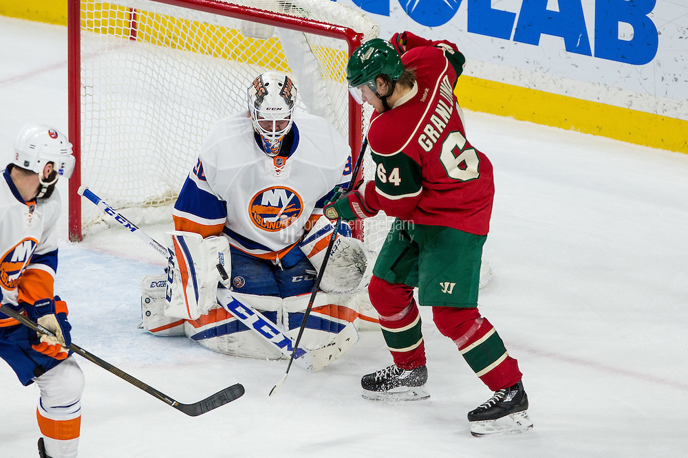 Dec 29, 2016; Saint Paul, MN, USA; New York Islanders goalie Jean-Francois Berube (30) makes a save on Minnesota Wild forward Mikael Granlund (64) during the third period at Xcel Energy Center. The Wild defeated the Islanders 6-4. Mandatory Credit: Brace Hemmelgarn-USA TODAY Sports