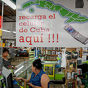 HIALEAH, FLORIDA - JUNE 24, 2016<br /> Cell phone stand in Noooo (&ntilde;oooo) Que Barato,  in Hialeah, Florida. Customers can buy state of the art phones or simply refill phone lines for family and friends in the island. The store sells all kinds of goods and is a very popular stop for Cubans who are traveling to Cuba to stock up on supplies to carry to relatives in the island nation.<br /> (Photo by Angel Valentin/Freelance)