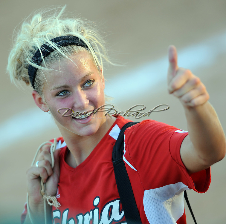 Elyria pitcher Tess Sito gives a thumbs-up to the fans in the stands after the Lady Pioneers' 11-2 victory over Mason.