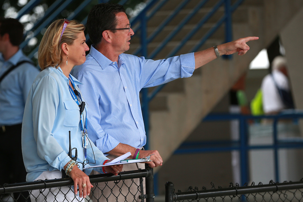 August 22, 2014, New Haven, CT:<br /> Tournament Director Anne Worcester and Connecticut Governor Dannel P. Malloy chat on day eight of the 2014 Connecticut Open at the Yale University Tennis Center in New Haven, Connecticut Friday, August 22, 2014.<br /> (Photo by Billie Weiss/Connecticut Open)