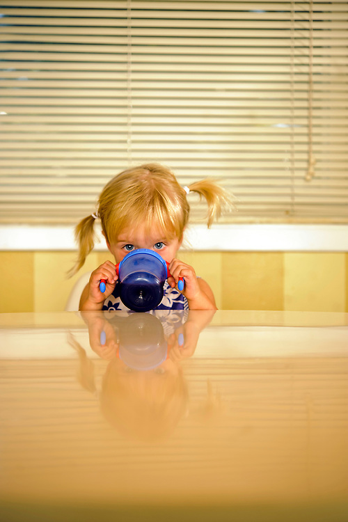 Photo by Matt Roth..Margot Ludwig, almost two, eating her lunch with mom Kendall Ludwig Wednesday, August 31, 2011.