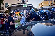 Roma 3 Giugno 2015<br /> Momenti di tensione al presidio anti-rom a Boccea, a Roma, cui hanno partecipato il movimento di estrema destra Casapound e alcuni comitati di quartiere. Una iniziativa contestata da antifascisti, e movimenti per la casa. Boccea è il quartiere dove mercoledì 27 maggio un'auto guidata da un 17enne  rom, ha investito nove persone e ucciso la 44enne filippina Corazon Abordo. La polizia in  tenuta antisommossa  allontana gli antifascisti<br /> Rome June 3, 2015<br /> Moments of tension to the protest anti-Roma Boccea in Rome, attended by the far-right movement Casapound and some neighborhood committees. An initiative opposed by anti-fascists, and movements for the house. Boccea is the neighborhood where Wednesday, May 27 car driven by a 17 year old Roma, has invested nine people and killed the 44 year old Filipino Corazon Abordo. Riot police remove the anti-fascists
