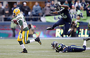 Green Bay Packers running back James Starks (44) eludes a tackle attempt by Seattle Seahawks free safety Earl Thomas (29) and leaping Seattle Seahawks defensive end Cliff Avril (56) as he runs for a fourth quarter gain of 32 yards to the Seattle Seahawks 43 yard line during the NFL week 20 NFC Championship football game against the Seattle Seahawks on Sunday, Jan. 18, 2015 in Seattle. The Seahawks won the game 28-22 in overtime. ©Paul Anthony Spinelli