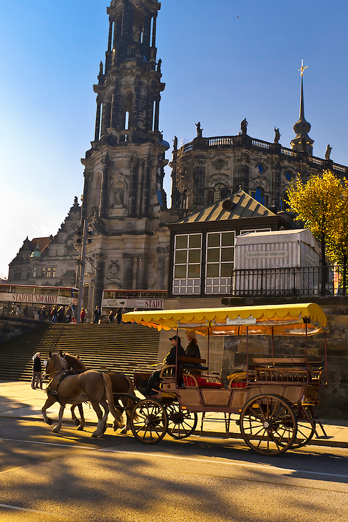 Horse drawn carriage passing in front of the Hofkirche (Dresden Cathedral), Dresden, Saxony, Germany