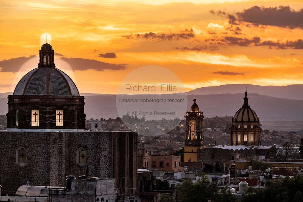 Sunset over the San Francisco Church, left, and the Church of the Immaculate Conception also called the Nuns in the historic center of San Miguel de Allende, Guanajuato, Mexico.