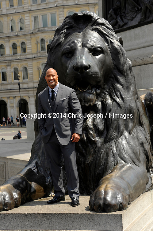 Image ©Licensed to i-Images Picture Agency. 02/07/2014. London, United Kingdom. Duane Johnson attends a photocall for 'Hercules' at Trafalgar Square. Picture by Chris Joseph / i-Images