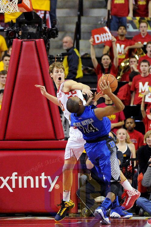 16 February 2013:   Maryland Terrapins guard/forward Jake Layman (10) fouls Duke Blue Devils guard Rasheed Sulaimon (14) at the Comcast Center in College Park, MD. where the Maryland Terrapins upset the second ranked Duke Blue Devils, 83-81.