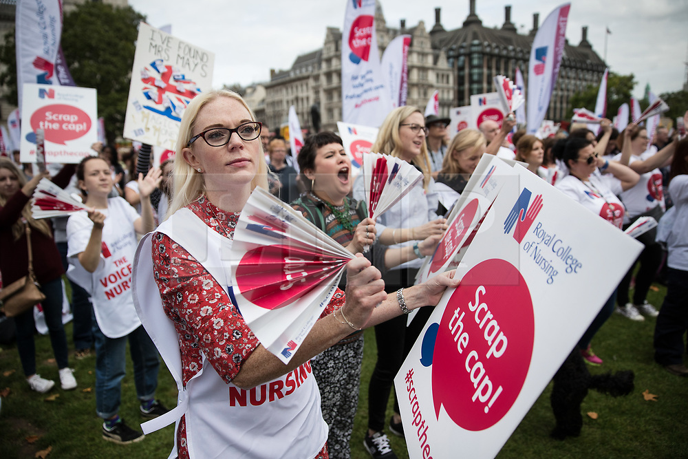 © Licensed to London News Pictures. 06/09/2017. London, UK. Nurses hold placards and applaud speeches during a demonstration in Parliament Square. The Royal College of Nursing is campaigning against the Government's one per cent cap on public sector pay. Photo credit: Peter Macdiarmid/LNP