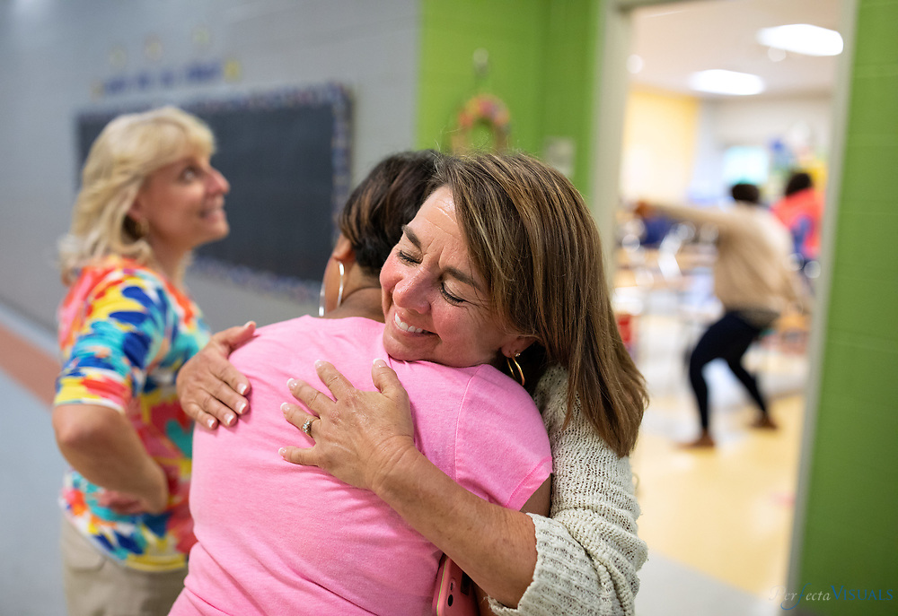 Last day of school at Ronald E. McNair Elementary School<br /> <br /> Allison Ewell, an assistant teacher, hugs<br /> K-teacher Jordan Hairston.<br /> <br /> Photographed, Tuesday, June 12, 2018, in Greensboro, N.C. JERRY WOLFORD and SCOTT MUTHERSBAUGH / Perfecta Visuals