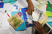Girl Scouts sort and bundle Holiday Cards created special for the U.S. Military during the Girl Scout USA of Northern California Operation Holiday Cards packing event at Mount Olive Ministries in Milpitas, California, on November 18, 2015. (Stan Olszewski/SOSKIphoto)