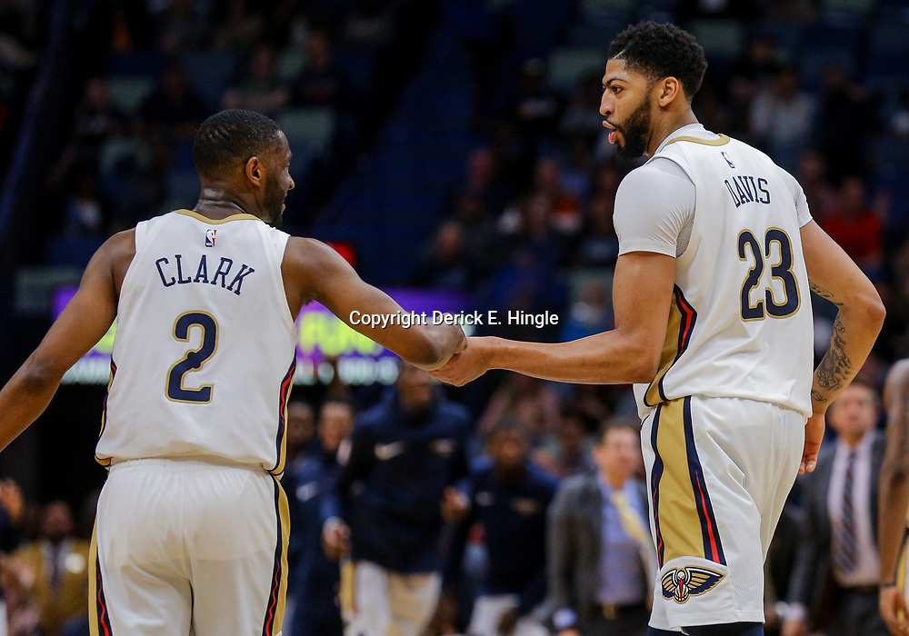 Mar 20, 2018; New Orleans, LA, USA; New Orleans Pelicans forward Anthony Davis (23) celebrates a basket with guard Ian Clark (2) during the fourth quarter at the Smoothie King Center. Pelicans defeated the Mavericks 115-105. Mandatory Credit: Derick E. Hingle-USA TODAY Sports