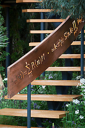 Illuminated mathematical symbols cut into band of copper to form bannister for staircase leading up the belvedere in the Winton Beauty of Mathematics,Chelsea Flower Show 2016.