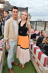 EMILY BERRINGTON and BEN LLOYD-HUGHES at the Warner Music Group Summer Party in association with British GQ held at Shoreditch House, Ebor Street, London E2 on 8th July 2015.
