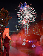 Port Jervis, NY - People watch fireworks explode in the sky over Port Jervis during the city's centennial celebration on July 28, 2007..