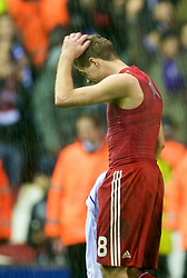 LIVERPOOL, ENGLAND - Wednesday, December 9, 2009: Liverpool's captain Steven Gerrard MBE walks off dejected after losing 2-1 to AFC Fiorentina during the UEFA Champions League Group E match at Anfield. (Photo by David Rawcliffe/Propaganda)