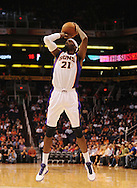 Oct. 22 2010; Phoenix, AZ, USA; Phoenix Suns power forward Hakim Warrick (21) puts up a basket during the first half against the Denver Nuggets during a preseason game at the US Airways Center. Mandatory Credit: Jennifer Stewart-US PRESSWIRE.