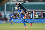 AFC Wimbledon striker Tom Elliott (9) and Portsmouth defender Christian Burgess (6) compete during the Sky Bet League 2 match between AFC Wimbledon and Portsmouth at the Cherry Red Records Stadium, Kingston, England on 26 April 2016.