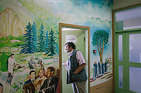 COMO, ITALY - 21 JUNE 2017: Giusto Della Valle, a local priest who since 2011 has run a center on the outskirts of town where more than 50 migrants sleep at night, opens a classroom for of the center, in Como, Italy, on June 21st 2017.<br /> <br /> Residents of Como are worried that funds redirected to migrants deprived the town's handicapped of services and complained that any protest prompted accusations of racism.<br /> <br /> Throughout Italy, run-off mayoral elections on Sunday will be considered bellwethers for upcoming national elections and immigration has again emerged as a burning issue.<br /> <br /> Italy has registered more than 70,000 migrants this year, 27 percent more than it did by this time in 2016, when a record 181,000 migrants arrived. Waves of migrants continue to make the perilous, and often fatal, crossing to southern Italy from Africa, South Asia and the Middle East, seeing Italy as the gateway to Europe.<br /> <br /> While migrants spoke of their appreciation of Italy's humanitarian efforts to save them from the Mediterranean Sea, they also expressed exhaustion with the country's intricate web of permits and papers and European rules that required them to stay in the country that first documented them.