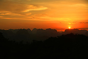 Sunset taken from on top of the Tiger Cave Temple (Wat Tham Suea จุดชมวิววัดถ้ำเสือ) in Krabi, Thailand. You need to walk up 1237 steps to get to the top. Once you're there, you'll have a 360 degree view of Krabi.