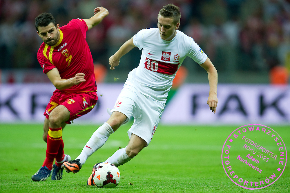 (R) Poland's Piotr Zielinski fights for the ball with (L) Montenegro's Simon Vukcevic during the 2014 World Cup Qualifying Group H football match between Poland and Montenegro at National Stadium in Warsaw on September 06, 2013.<br /> <br /> Poland, Warsaw, September 06, 2013<br /> <br /> Picture also available in RAW (NEF) or TIFF format on special request.<br /> <br /> For editorial use only. Any commercial or promotional use requires permission.<br /> <br /> Mandatory credit:<br /> Photo by &copy; Adam Nurkiewicz / Mediasport