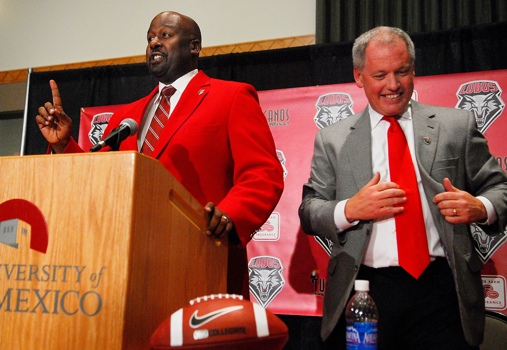 12.09.08/Newly hired head football coach by the University of New Mexico is Mike Locksley(Cq) seen here on the left along with Athletics director Paul Krebs(Cq)right during his introduction at the student union building. roberto e. rosales