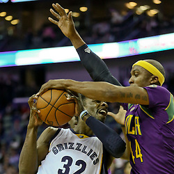 Feb 1, 2016; New Orleans, LA, USA; New Orleans Pelicans forward Dante Cunningham (44) steals the ball from Memphis Grizzlies forward Jeff Green (32) during the second quarter of a game at the Smoothie King Center. Mandatory Credit: Derick E. Hingle-USA TODAY Sports