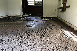 Interior view inside an abandoned property in Middleburg, FL, on September 13, 2017. Residents of homes near Black Creek, Clay County, Florida return to find homes submerged by historic 28.5-foot flooding after Hurricane Irma took an unexpected turn and caused major damages in the region.