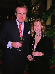MR & MRS JUSTIN CADBURY at a party in London on 25th November 1997.<br /> MDR 19