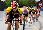 A cyclist competes in the masters cat 4/5 race of the 2014 Duluth Georgia Cup cycling event on Saturday in Duluth. (Staff Photo: David Welker)