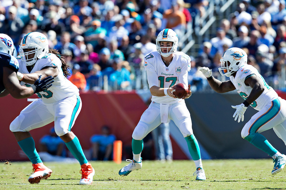 NASHVILLE, TN - OCTOBER 18:  Ryan Tannehill #17 fakes a handoff to Lamar Miller #26 of the Miami Dolphins during a game against the Tennessee Titans at LP Field on October 18, 2015 in Nashville, Tennessee.  The Dolphins defeated the Titans 38-10.  (Photo by Wesley Hitt/Getty Images) *** Local Caption *** Ryan Tannehill; Lamar Miller