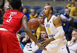 Dec 20, 2016; Morgantown, WV, USA; West Virginia Mountaineers guard Jevon Carter (2) looks to pass during the second half against the Radford Highlanders at WVU Coliseum. Mandatory Credit: Ben Queen-USA TODAY Sports
