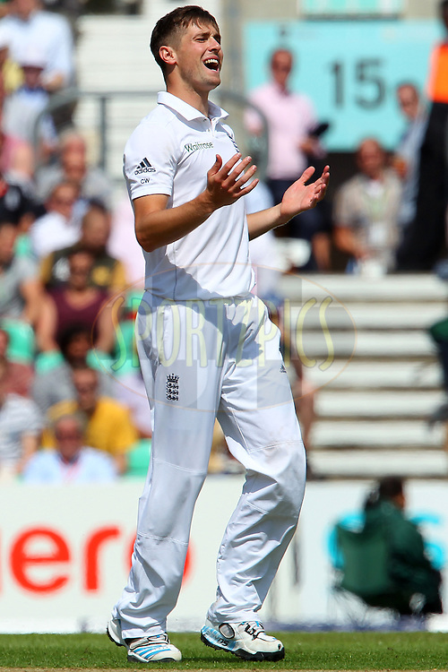 Chris Woakes of England reacts after a delivery during day one of the fifth Investec Test Match between England and India held at The Kia Oval cricket ground in London, England on the 15th August 2014<br /> <br /> Photo by Ron Gaunt / SPORTZPICS/ BCCI