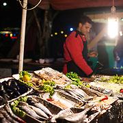 Vendors grilling fresh fish in Karakoy, Istalnbul.
